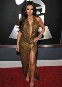 Ким Кардашьян в золотом платье